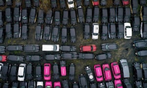 Cabs parked today in a field in Epping Forest, which is being rented by GB Taxi Services to store their large fleet of London taxis that are no longer being used due to a severe drop in demand because of coronavirus.