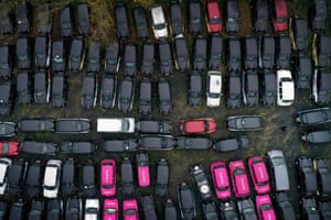 Epping Forest, England. A fleet of London black cabs parked on farmland after a severe drop in demand due to coronavirus restrictions.