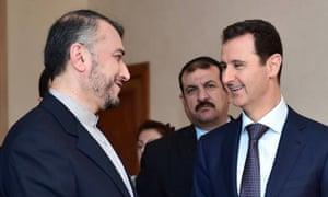 Iran's deputy foreign minister, Hossein Amir Abdollahian (left) and Bashar al-Assad