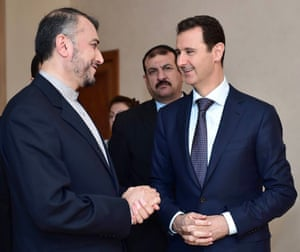 Syrian President Bashar Assad, right, speaks with Iran's Deputy Foreign Minister Hossein Amir Abdollahian, left, in Damascus, Syria, in 2015.