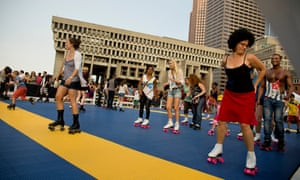 A mass Donna Summer roller disco tribute takes palce outside Boston City Hall.