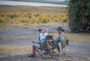 Nicky and husband Ian bird watching in their campsite in Chobe national park.