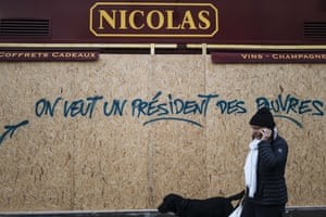 Graffiti on a wine shop reads 'we want a president for the poor'
