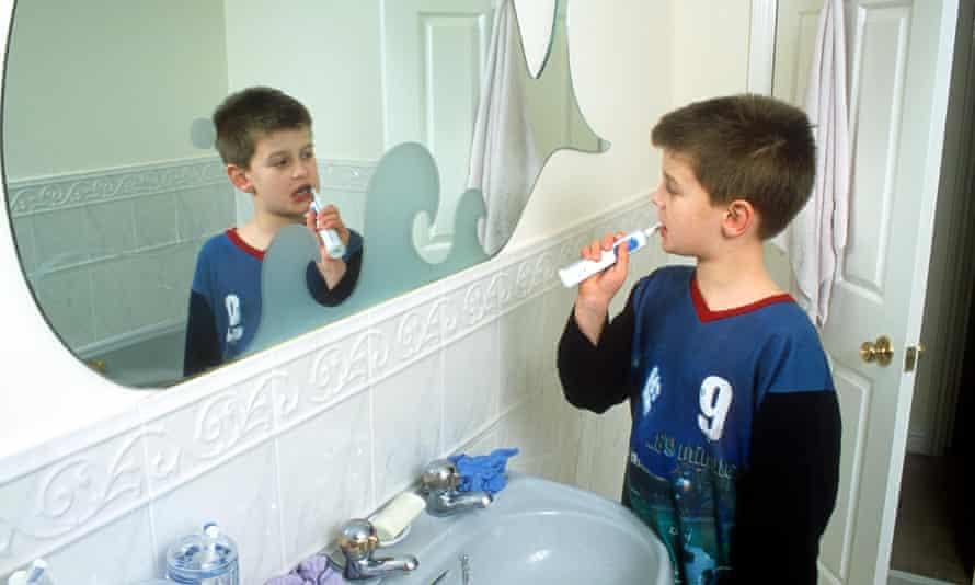 Boy brushing teeth