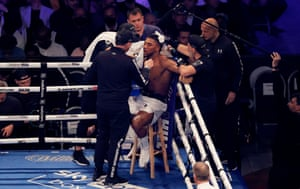 An exhausted looking Anthony Joshua on his stool.