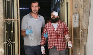 A man receives treatment after an airstrike in Aleppo this week. On Friday the M10 hospital was hit for second time in two weeks.