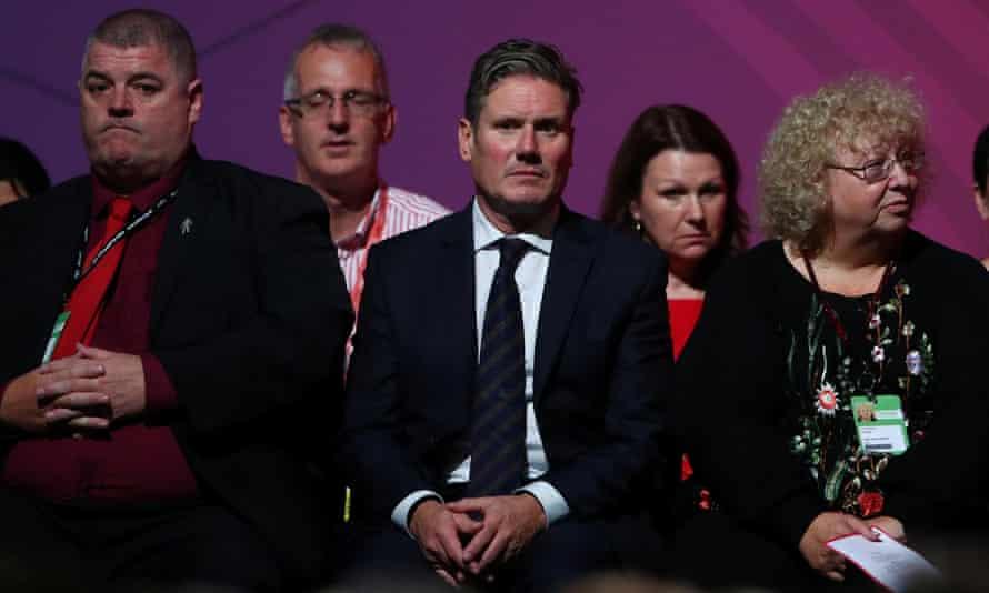 The shadow Brexit secretary, Keir Starmer, listens to Corbyn's speech.