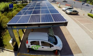 An electric car charged at a solar power carport in Shanghai, China.