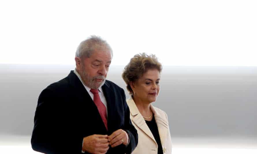 Luiz Ignácio Lula da Silva walks with Dilma Rousseff in March.