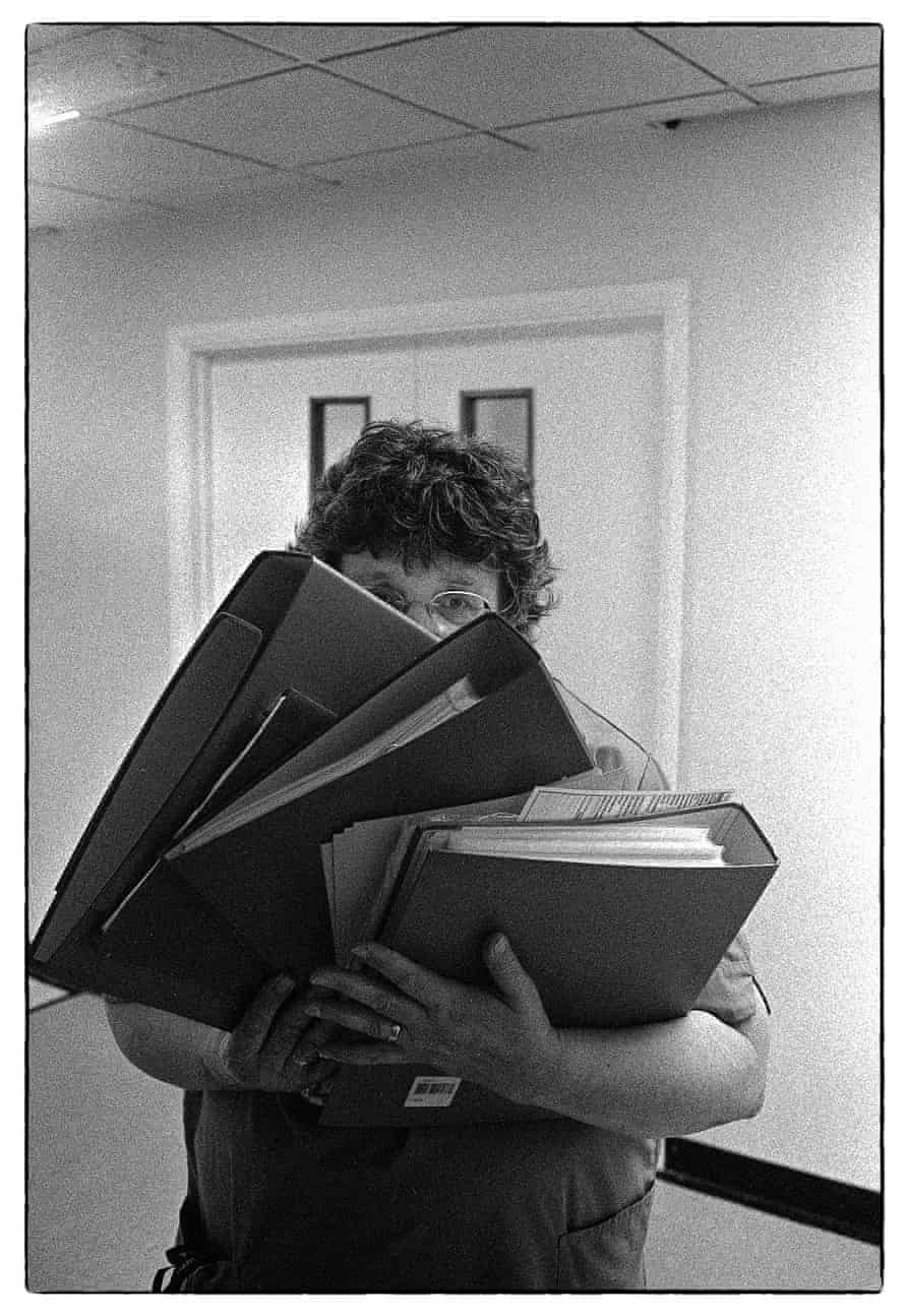 A staff member is seen carrying folders at Nevill Hall hospital in Abergavenny