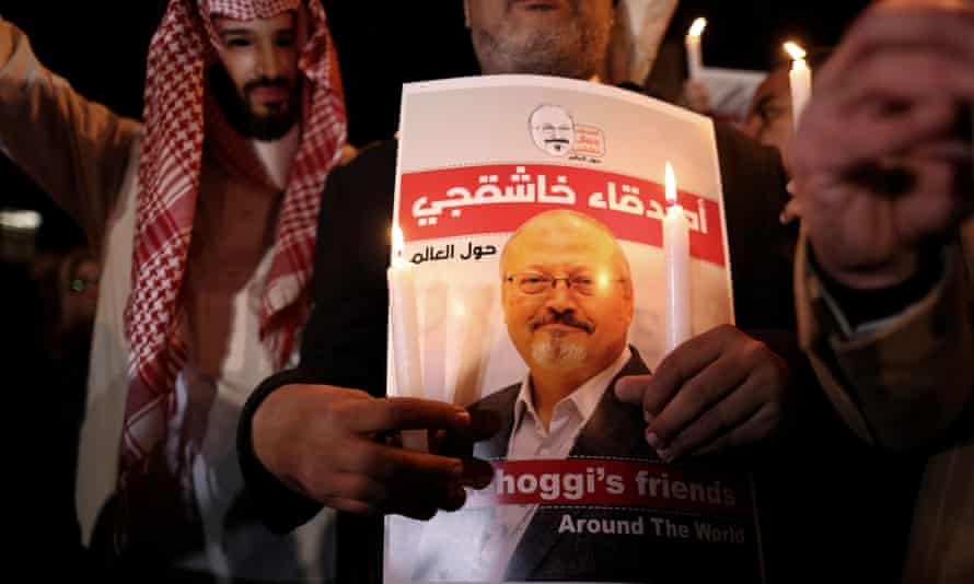 A protester, left, wears a mask depicting Mohammad bin Salman during a demonstration calling for justice for Jamal Khashoggi in Istanbul