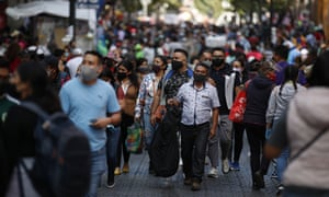 Shoppers in Mexico City wear masks.