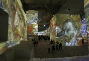 People attend an exhibition of projections of the most famous works of art by Vincent van Gogh in France