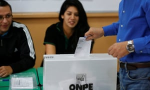 A man casts his ballot in Peru's presidential election at a voting station in Lima on Sunday.