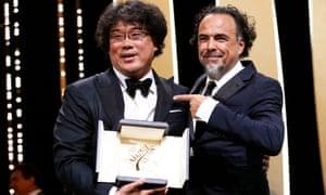 'An outstanding film' … Bong Joon-ho with jury president Alejandro Gonzalez Inarritu.