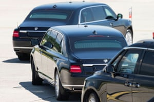The limousine carrying Putin leaves the airport in a motorcade