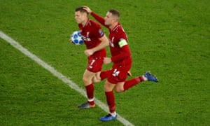 Liverpool's James Milner celebrates scoring their first goal with Jordan Henderson