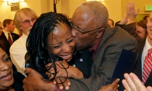 Republican Mia Love celebrates with her father, Jean Maxime Bourdeau, after winning the race for Utah's 4th Congressional District in 2014. Love is a rising star in the GOP, and wants her party to take action to address climate change.