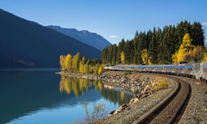 Passenger train along Moose Lake in Jasper National Park, Alberta, Canada.