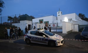 Police officers stand in front of the Bayonne mosque in south-west France