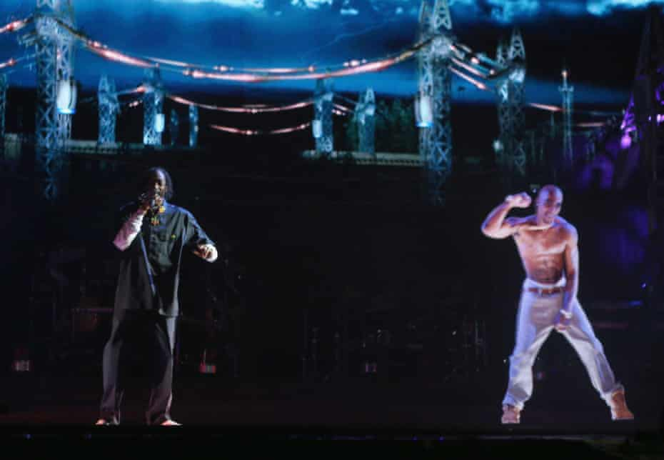 Snoop Dogg, left, duets with a hologram of Tupac Shakur (who died in 1996) at Coachella festival in 2012.