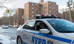 A NYPD vehicle patrols near the Marcy Houses public housing development in the Brooklyn borough of New York.