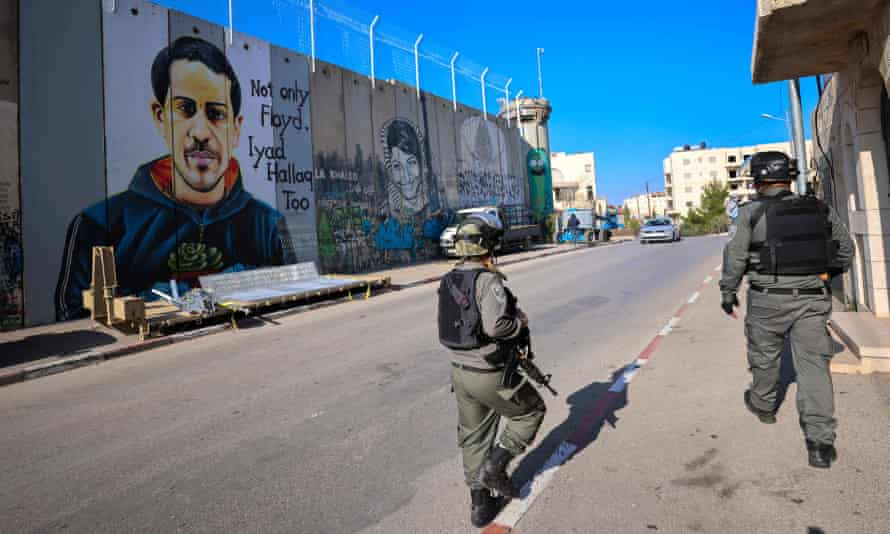 Israeli soldiers patrol next to the separation barrier in Bethlehem, West Bank
