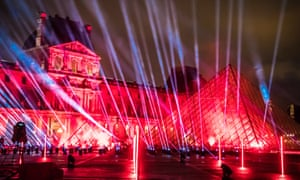 Lights are projected on the Louvre's pyramid for a 'United at Home' performance of the French DJ David Guetta, which will be broadcast on New Year's Eve.