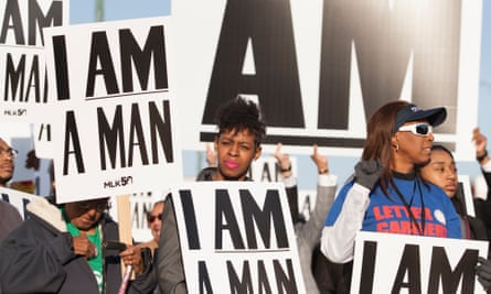People carrying union signs and signs with the 'I Am A Man' slogan from the 1968 sanitation workers strike gather for a rally on Beale Street in Memphis.
