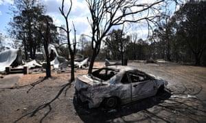burnt car and house