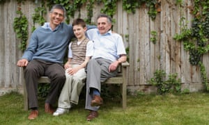 Family portrait of grandfather, father and son in garden