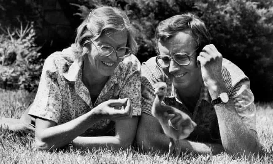 Alan and Joan Root studying a baby crane, native to Kenya, at Bronx Zoo, New York.