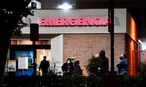 People wait outside the emergency room of the Garfield medical center in Monterey Park, California.