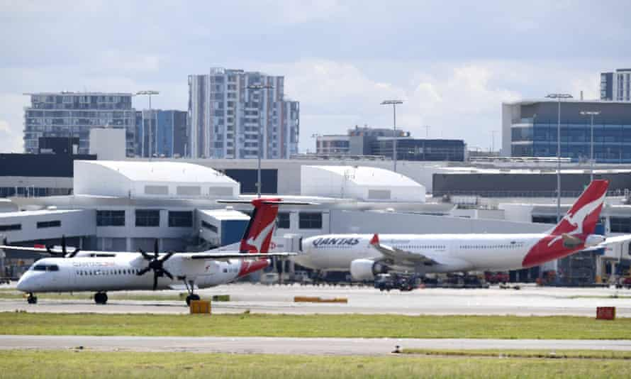 Qantas aircraft at Sydney airport. The airlines has slashed international flights by 90% until the end of May.