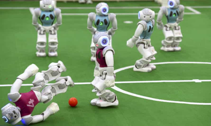 A robot falls in a soccer match at RoboCup 2015, in China.