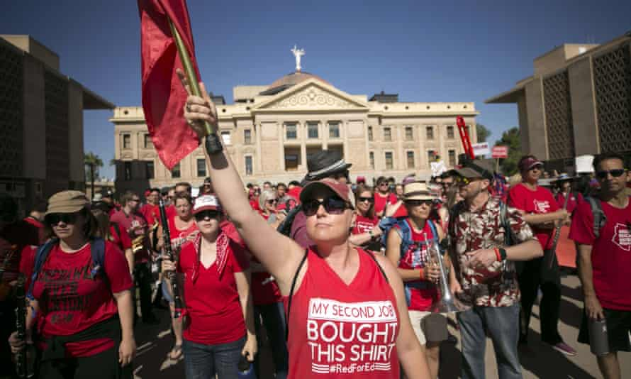 Jill Schroeder, a teacher at Gilbert Public Schools, leads the RedForEd Spirit Band during the sixth day of the Arizona teacher walkout at the Arizona state capitol in Phoenix.