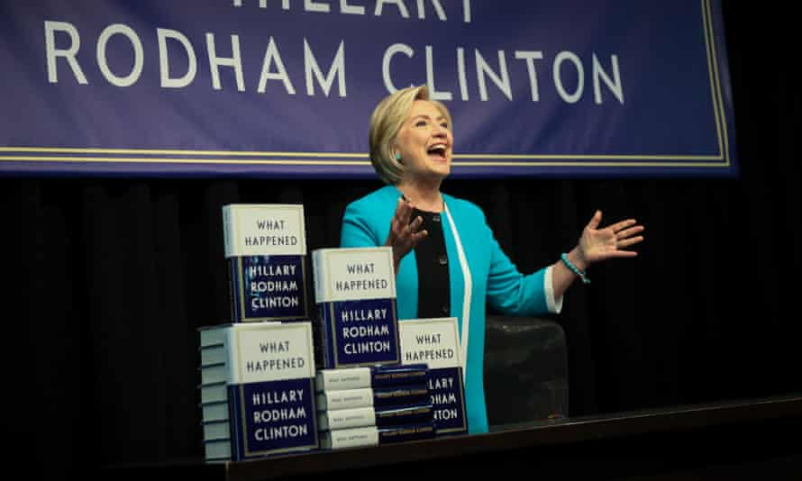 Hillary Clinton signing copies of her new book.