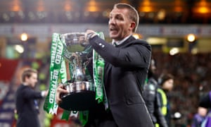 Celtic manager Brendan Rodgers with the trophy – his first in management