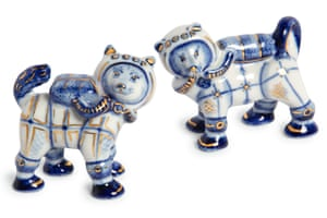 Hand-painted Gzhel porcelain figurines of Belka and Strelka wearing cosmonaut suits and breathing apparatus.