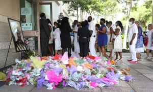 Family and friends enter the Fountain of Praise church in Houston.