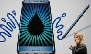 A woman passes an advert for the Samsung Galaxy Note 7 in London