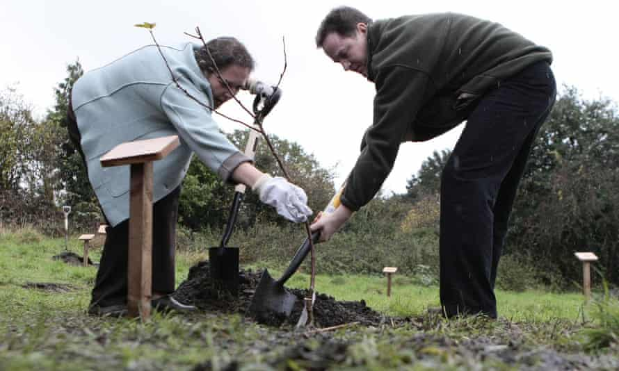 Liberal Democrat Party leader Nick Clegg and Susan Kramer, MP for Richmond Park, plant a tree on the site.
