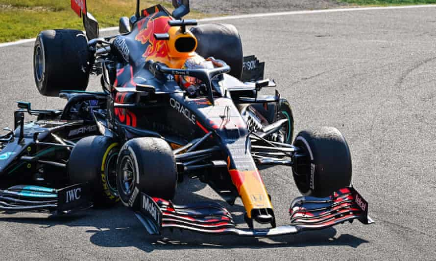 Max Verstappen's car is on top of Lewis Hamilton's Mercedes, but Hamilton survived thanks to the halo.