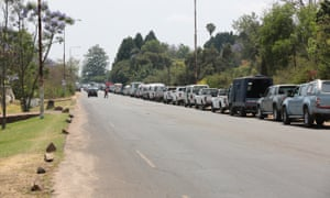 Vehicles wait to fill up at a petrol station in Harare.
