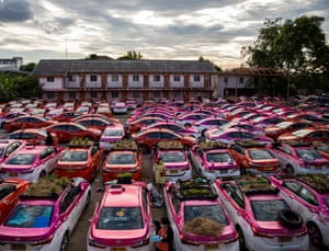 The community garden built on top of out-of-use taxis at the Ratchaphruek Taxi Cooperative in Bangkok, Thailand. Staff members of the taxi rental company care for a community garden set up by the company's owner. Due to the pandemic and strict quarantine measures put in place by the Thai government, taxi rental companies have seen a significant drop in business due to the lack of international tourism. The Ratchaphruek Taxi Cooperative's owners set up the community garden, using hoods and roofs of Thai taxis as planters for various vegetables, as a means to provide stress relief and some food to their employees.