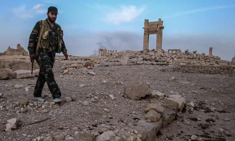 A Syrian government army officer guards the Temple of Bel