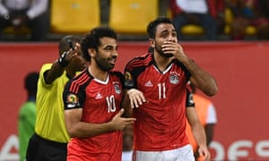 Karahba (right) celebrates his late winner with team-mate Mohamed Salah.