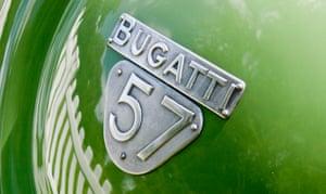 The badge of a 1938 green Bugatti 57C
