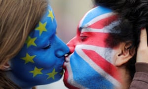Two activists with the EU flag and Union Jack painted on their faces kiss in front of the Brandenburg Gate, Berlin, 19 June, 2016.