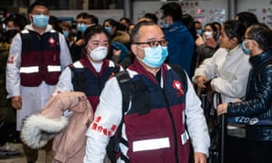 Members of a medical team prepare to leave for Wuhan, Hubei province